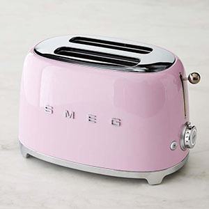 Retro pink toaster with the word Smeg printed on it photo