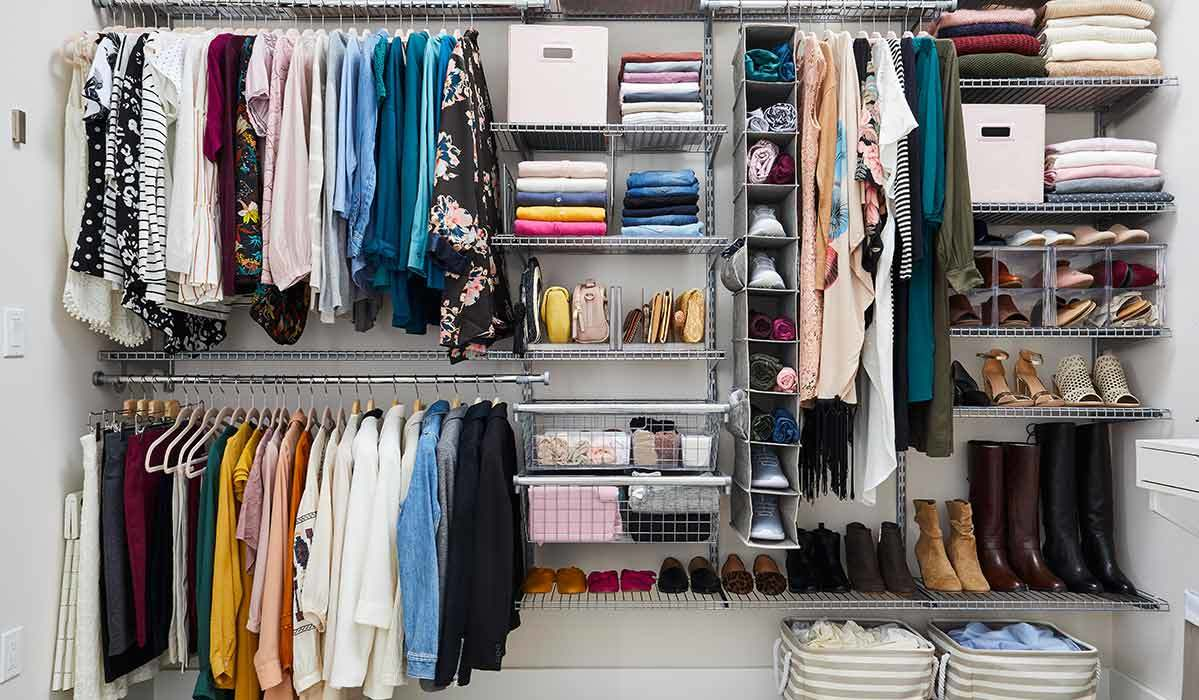 Closet with hanging clothes and stacked shoes photo