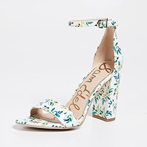 White block heels with a floral print photo