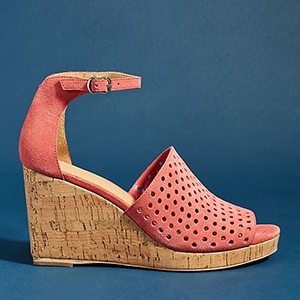 Pink sandals with a cork wedge against a blue background photo