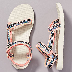 White, pink, and blue Teva sandals photo