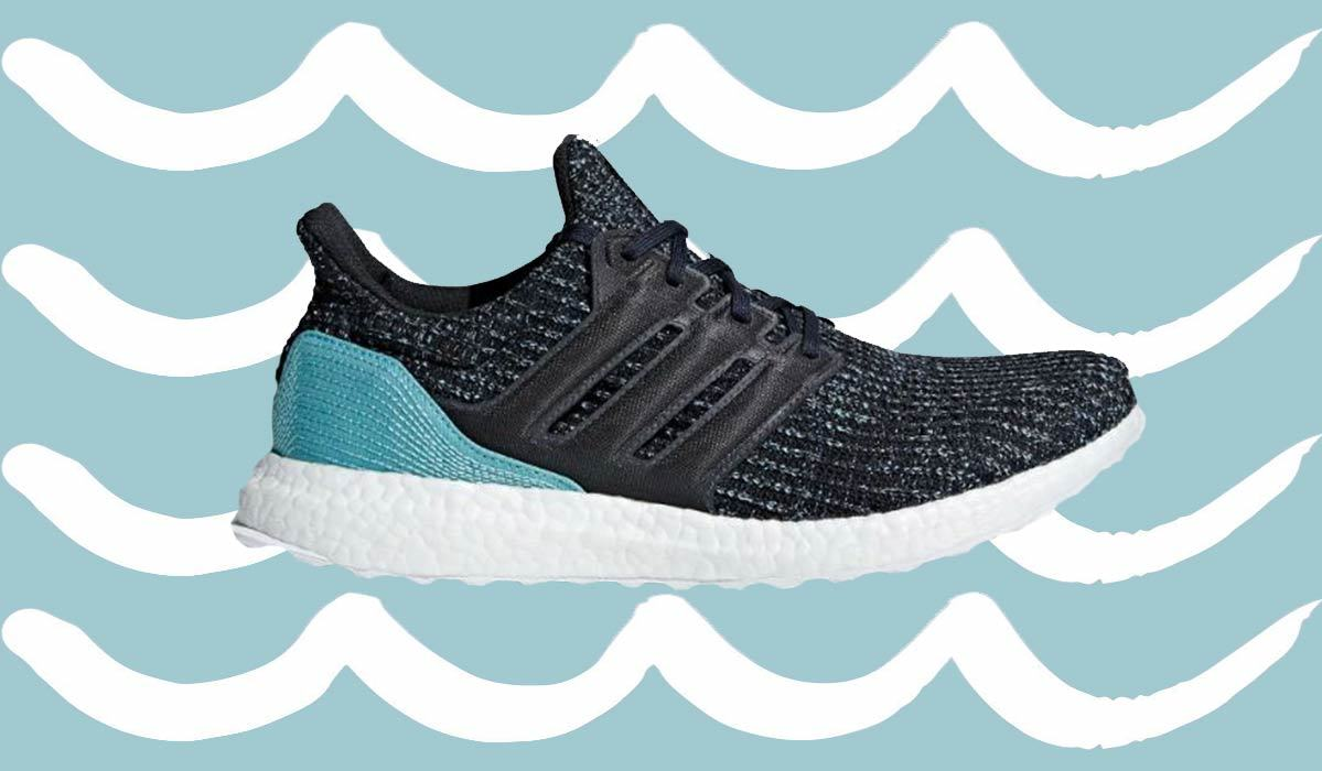 Black and blue running sneaker with a white bottom photo