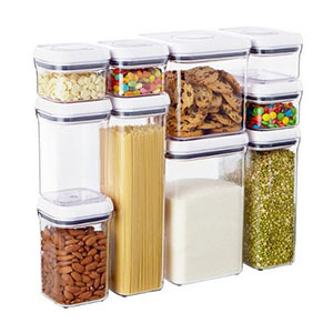 Set of 10 storage canisters stacked on top of one another photo