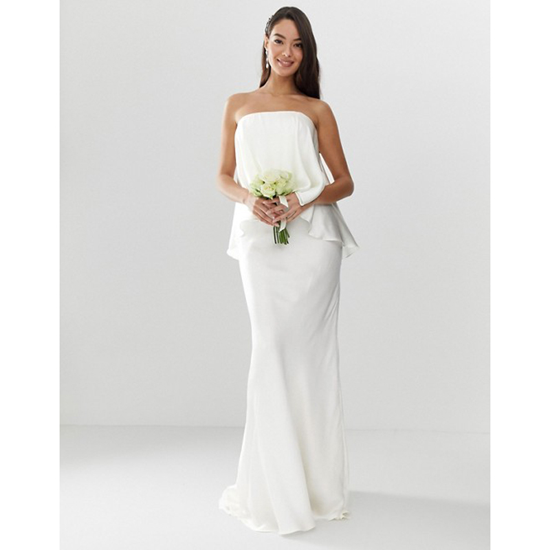 Model posing in ASOS Edition Satin Overlay Bandeau Wedding Dress photo