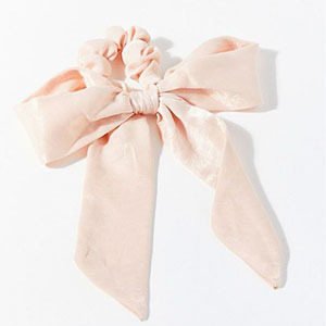 Pink bow on a scrunchie photo