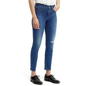 Medium-wash Levi's high-waist skinny jeans with ripped knee photo