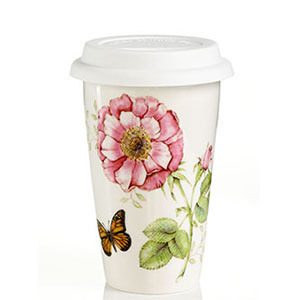 White mug with a butterfly and flower print photo