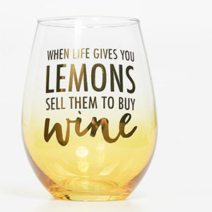 Yellow and clear stemless wine glass with words photo