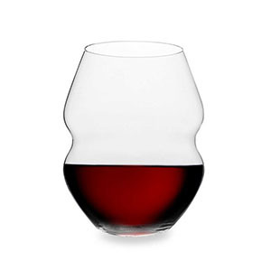 Red stemless wine glass with a dented middle photo
