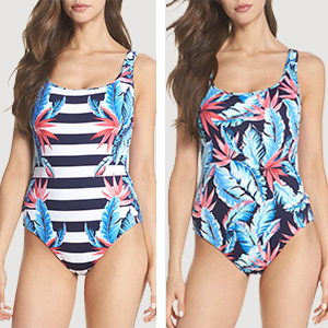 Woman wearing a striped and tropical reversible one-piece swimsuit photo