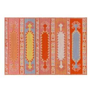 A rectangular reddish orange rug with a blue and yellow tribal pattern photo