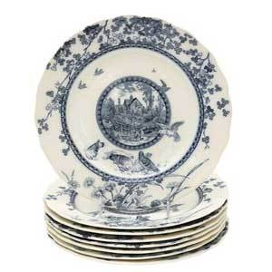 Blue and cream antique plate with a nature scene photo