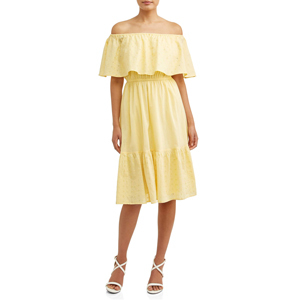 Woman wearing a yellow off-the-shoulder midi dress with white strappy heels. photo