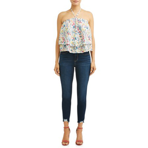 Woman wearing a floral halter top with dark skinny jeans and heels. photo