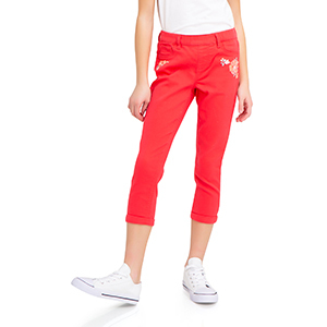 Girls crop jegging in reddish-pink color paired with white sneakers. photo