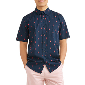 Man wearing a navy blue patterned button-down shirt with light pink shorts. photo