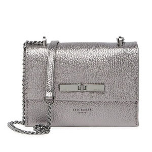 Metallic silver mini crossbody bag with a chain and leather strap and metal emblem on the flap photo