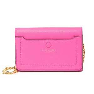 A bright pink crossbody bag with a gold chain strap photo
