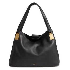 Black pebbled leather handbag with the handle upright and gold detailing photo