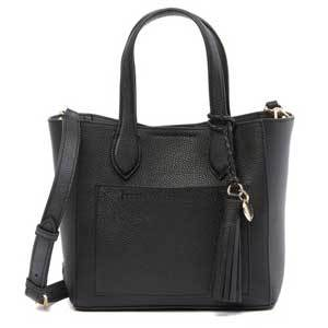 Black leather satchel with silver zippers and a front pocket photo