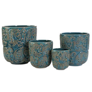 Set of four teal planters of different sizes with paisley pattern photo