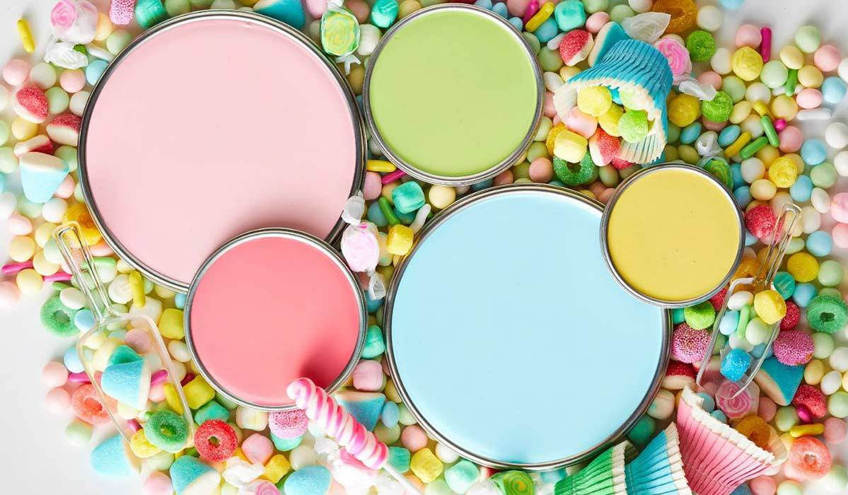 Colorful candies and paint with pastel paint colors photo