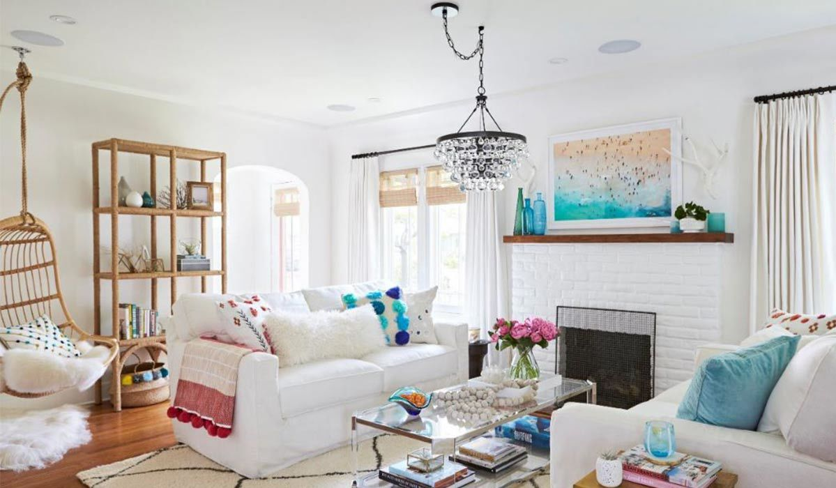 Living room with white and blue accents and a fireplace photo