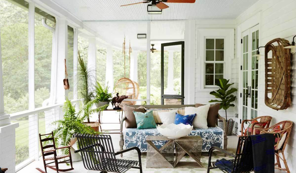 Porch with multiple chairs and a couch photo