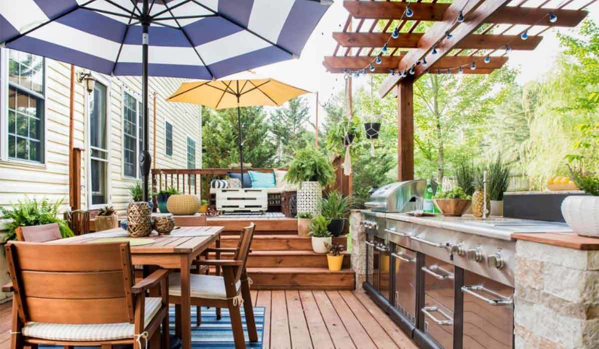 Deck with a table, ovens, and a grill photo