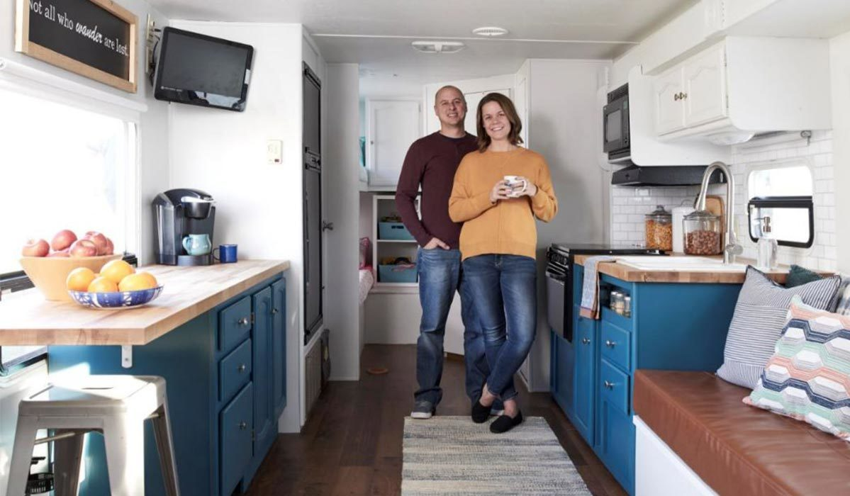 A couple standing in a mobile home with blue accents photo
