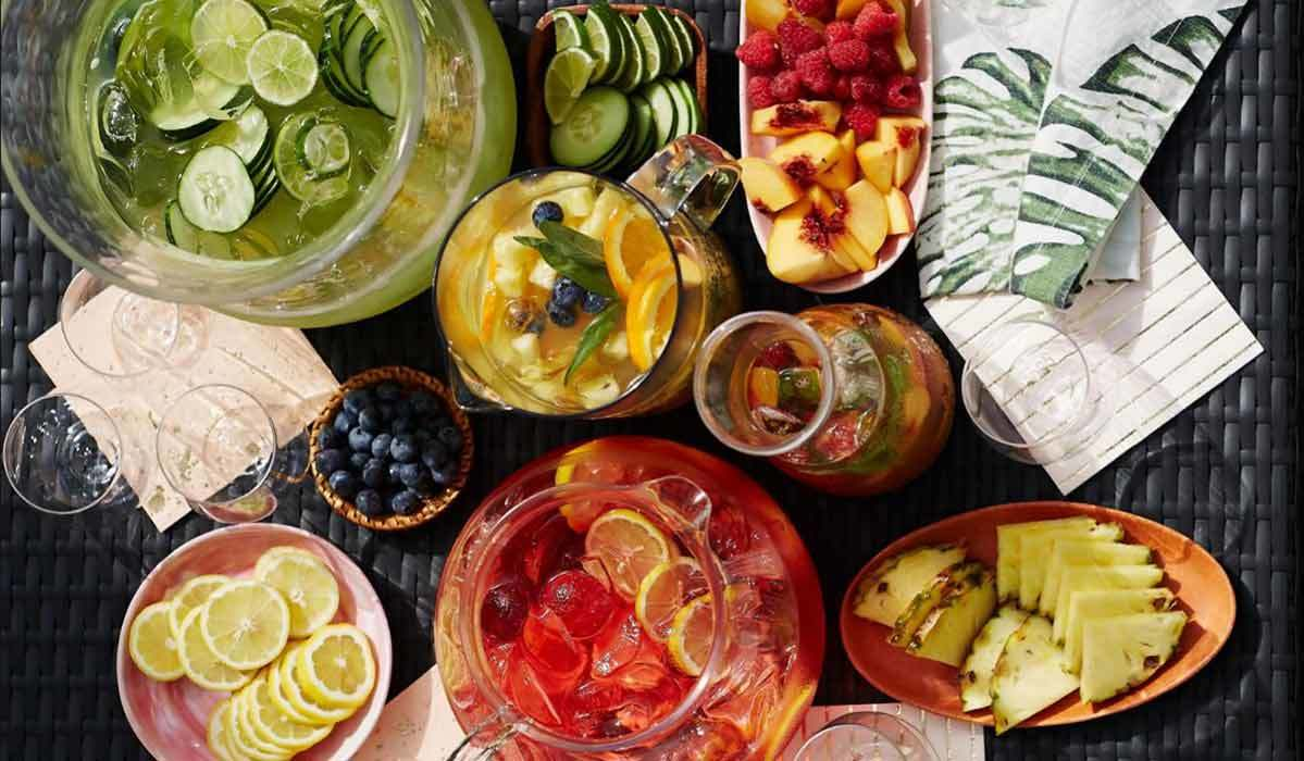 Multiple pitchers with colorful drinks and fruits photo