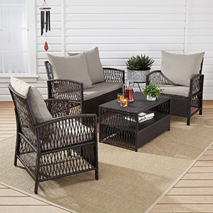 Dark and light brown patio furniture featuring two chairs, a loveseat, and a coffee table. photo