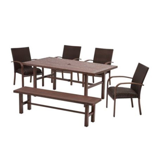 Patio dining set with four chairs and a bench photo