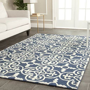 Blue rug with a white Moroccan motif design photo