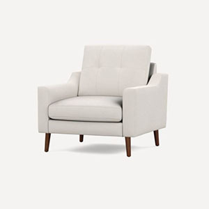 White armchair with brown legs and curved arms photo