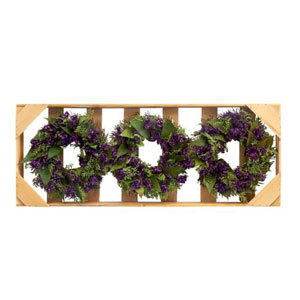 Three small green wreaths with purple flowers in a light mountable wooden box photo