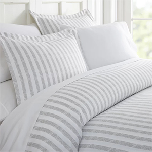White and light gray striped duvet cover and pillow shams photo