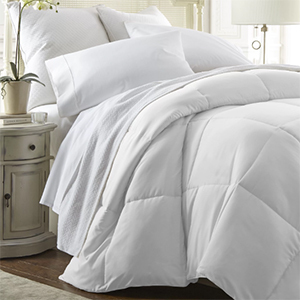 Plush white duvet on a bed with matching pillows photo