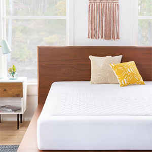 White Sheet waterproof and hypoallergenic mattress cover on a bed photo