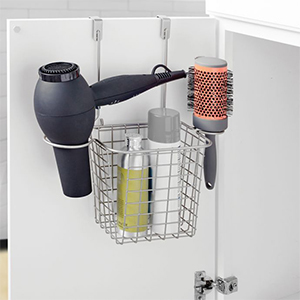 Wire over-the-door caddy under a bathroom sink with styling products photo