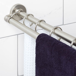 Silver Titan NeverRust Double Shower Rod with a towel hanging from it photo