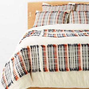 Duvet cover with a checkered pattern and fringe details photo