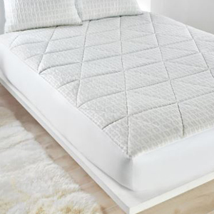 White mattress cover by DKNY photo