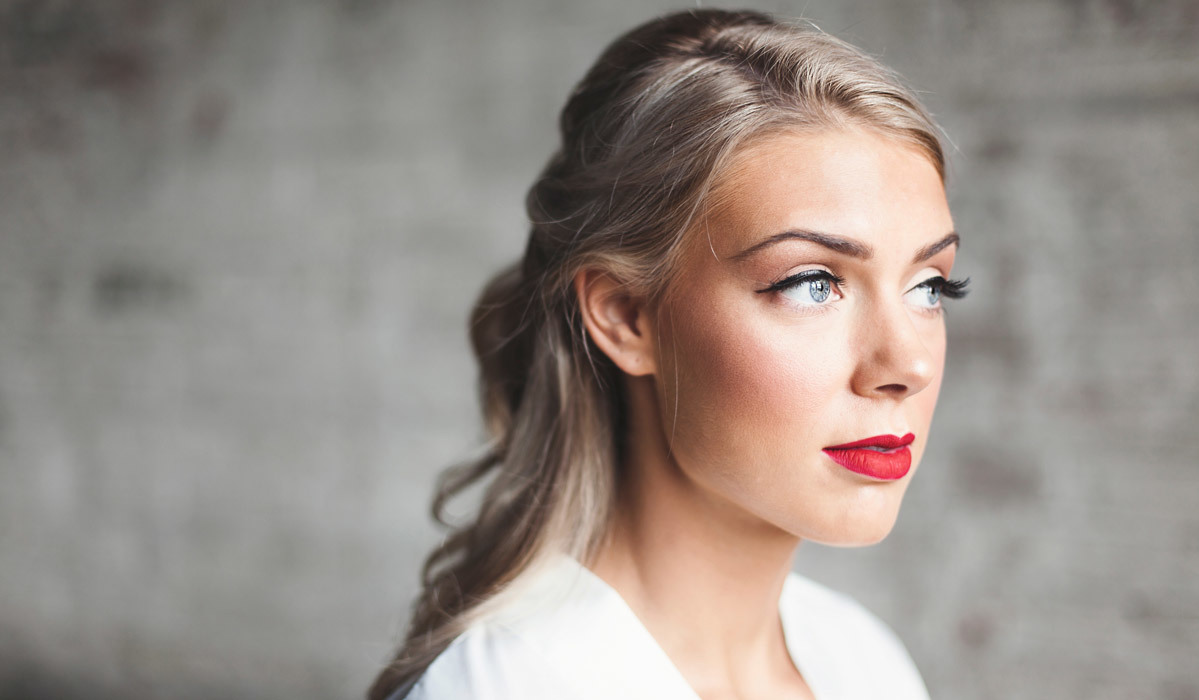 Young bride looking off into the distance with her hair and makeup done photo