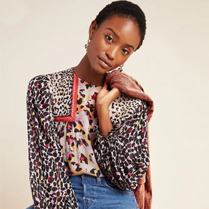 A long sleeve leopard patchwork blouse from Anthropologie photo