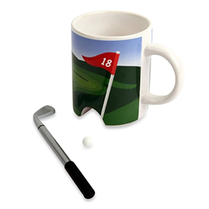 Coffee mug with small golf ball and mini putter pen photo