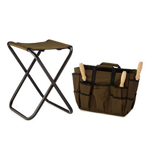 Dark green foldable stool and tool bag with garden tools photo