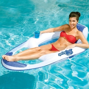 A woman lounges on a SwimWays Spring Float lounge chair in the pool photo