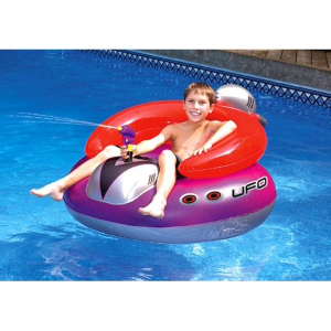 A boy sits in the Swimline UFO Squirter lounge float photo