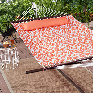 Coral patterned hammock on a deck photo